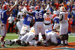 Florida players, including tight end Kemore Gamble (88) and offensive lineman Nick Buchanan (66) signal a touchdown as running back Lamical Perine scores in the pileup at the goal line during the first half of an NCAA college football game, Saturday, Sept. 21, 2019, in Gainesville, Fla. (AP Photo/John Raoux)