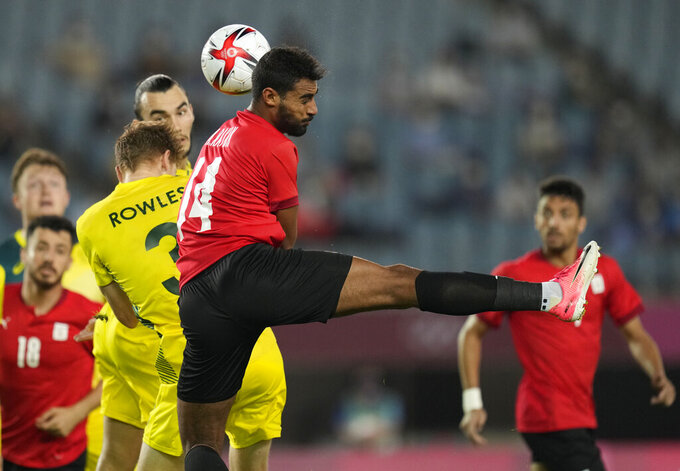 Egypt's Ahmed Rayan, center, goes for a header with Australia's Kye Rowles during a men's soccer match at the 2020 Summer Olympics, Wednesday, July 28, 2021, in Sendai, Japan. (AP Photo/Andre Penner)