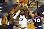Missouri's Jeremiah Tilmon, center, passes the ball from between Liberty's Micaiah Abii, left, and Elijah Cuffee during the first half of an NCAA college basketball game Wednesday, Dec. 9, 2020, in Columbia, Mo. (AP Photo/L.G. Patterson)