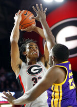 Georgia forward Nicolas Claxton (33) looks to shoot while defended by LSU forward Darius Days (22) during an NCAA college basketball game in Athens, Ga., Saturday, Feb. 16, 2019. (Joshua L. Jones/Athens Banner-Herald via AP)