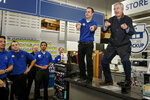 FILE - In this Nov. 26, 2015, file photo, Best Buy CEO Hubert Joly, right, leads a cheer for employees with store manager Brian Maciej before the store opens on Thanksgiving, in Minnetonka, Minn. The CEO credited with reviving a struggling Best Buy is stepping aside. Hubert Joly, 59, is handing leadership of the reinvigorated electronics retailer to longtime executive Corie Barry, 43, as part of the company's succession plan effective June 11.(AP Photo/Bruce Kluckhohn, File)