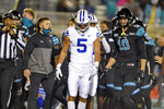 BYU's Dax Milne (5) and Coastal Carolina's Grayson McCall (10) walk off the field after an NCAA college football game Saturday, Dec. 5, 2020, in Conway, S.C. Coastal Carolina won 22-17. (AP Photo/Richard Shiro)