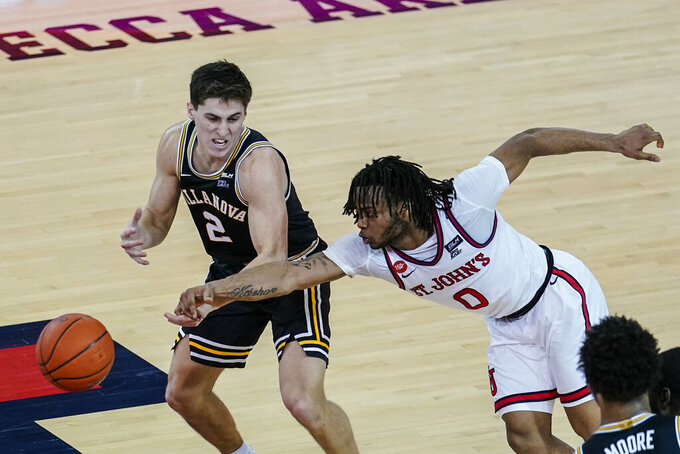 St. John's Posh Alexander (0) knocks the ball away from Villanova's Collin Gillespie (2) during the second half of an NCAA college basketball game Wednesday, Feb. 3, 2021, in New York. (AP Photo/Frank Franklin II)