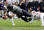 Northwestern quarterback Clayton Thorson, left, scores a touchdown past Wisconsin cornerback Madison Cone during the first half of an NCAA college football game in Evanston, Ill., Saturday, Oct. 27, 2018. (AP Photo/Nam Y. Huh)