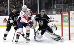 Washington Capitals' Travis Boyd (72) tries to deflect the puck past Los Angeles Kings goaltender Jonathan Quick, right, during the first period of an NHL hockey game Wednesday, Dec. 4, 2019, in Los Angeles. (AP Photo/Marcio Jose Sanchez)