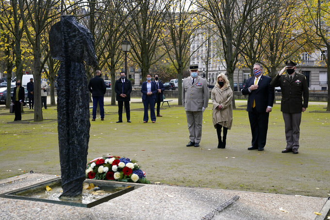 Secretary of State Mike Pompeo, second from right, pauses as he participates in a wreath-laying ceremony in homage to victims of terrorism at Les Invalides in Paris, Monday, Nov. 16, 2020. Standing with Pompeo are Lt. Colonel Jean-Charles Spiteri, Deputy Chief of Staff for the Military Governor of Paris, from left, U.S. Ambassador to France Jamie McCourt and U.S. Army Lt. Gen. Ricky Waddell. (AP Photo/Patrick Semansky, Pool)