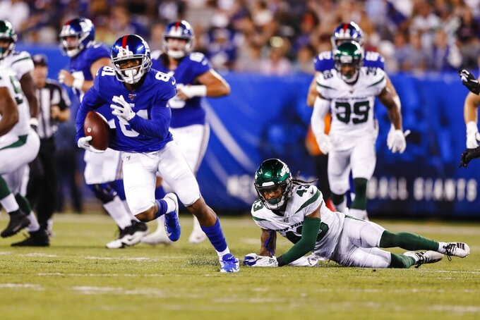 New York Jets defensive back Parry Nickerson (43) watches as New York Giants' Russell Shepard (81) runs for a touchdown during the first half of a preseason NFL football game Thursday, Aug. 8, 2019, in East Rutherford, N.J. (AP Photo/Michael Owens)
