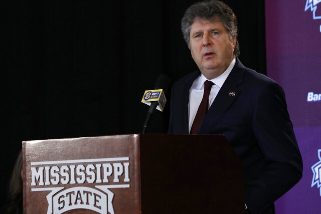 FILE - In this Jan. 10, 2020, file photo, new Mississippi State football coach Mike Leach, speaks before reporters and school supporters at the university in Starkville, Miss., after being officially introduced as the head coach. Leach apologized Thursday, April 2, 2020, for a tweet that displayed a meme of a woman knitting her husband a noose as they were self-quarantined. Leach removed the tweet, which was posted Wednesday night. He posted on Twitter that he didn't mean to offend anyone. (AP Photo/Rogelio V. Solis, File)