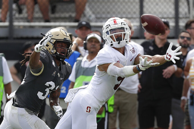 Stanford wide receiver Osiris St. Brown can't make the catch as his is covered by Central Florida defensive back Aaron Robinson during the first half of an NCAA college football game, Saturday, Sept. 14, 2019, in Orlando, Fla. (AP Photo/John Raoux)