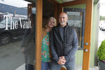 Stephanie Skoglund poses for a photo with her husband, Rick, in the main entrance to The Vault, the wedding and event center she owns in Tenino, Wash., on July 1, 2020. Skoglund's schedule at her two wedding and event venues was packed with dozens of events before the coronavirus outbreak forced her to close her doors in mid-March and left her business, like so many others, on the brink. (AP Photo/Ted S. Warren)