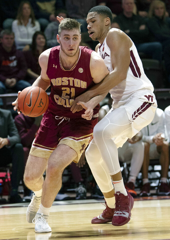 Boston College forward Nik Popovic (21) drives to the basket against Virginia Tech forward Kerry Blackshear Jr. (24) during the first half of an NCAA college basketball game Saturday, Jan. 5, 2019, in Blacksburg, Va. (AP Photo/Don Petersen)