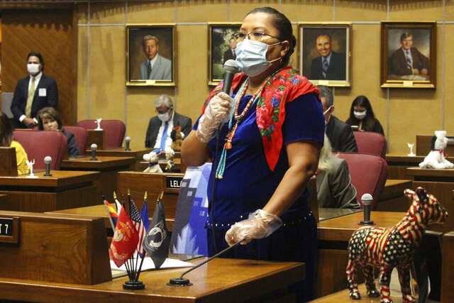 Democratic state Sen. Jamescita Peshlakai wears a mask as she tells member how the coronavirus has devastated the Navajo Nation while urging members to approve a move to end the legislative session at the state Capitol in Phoenix, Friday, May 8, 2020. The Senate by a 24-6 vote approved a move to adjourn pending approval by the House. (AP Photo/Bob Christie)
