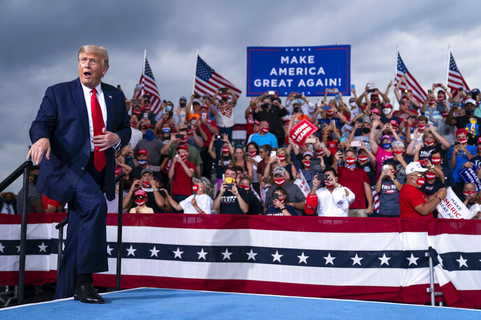 President Donald Trump reacts to the crowd as he arrives to speak at a campaign rally at Smith Reynolds Airport, Tuesday, Sept. 8, 2020, in Winston-Salem, N.C. (AP Photo/Evan Vucci)