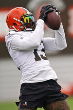 Cleveland Browns wide receiver Odell Beckham Jr. catches a pass during practice at the NFL football team's training camp facility, Tuesday, Aug. 17, 2021, in Berea, Ohio. (AP Photo/Tony Dejak)
