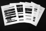Special counsel Robert Mueller's redacted report on the investigation into Russian interference in the 2016 presidential election is photographed Thursday, April 18, 2019, in Washington. The pages deal with Julian Assange and WikiLeaks(AP Photo/Jon Elswick)