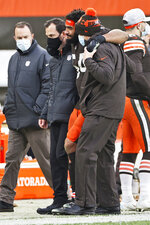 Cleveland Browns defensive end Olivier Vernon is helped off the field after an injury during the second half of an NFL football game against the Pittsburgh Steelers, Sunday, Jan. 3, 2021, in Cleveland.  (AP Photo/Ron Schwane, File)