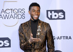 FILE - In this Jan. 27, 2019 file photo, Chadwick Boseman arrives at the 25th annual Screen Actors Guild Awards at the Shrine Auditorium & Expo Hall in Los Angeles.  Boseman, who played Black icons Jackie Robinson and James Brown before finding fame as the regal Black Panther in the Marvel cinematic universe, has died of cancer. His representative says Boseman died Friday, Aug. 28, 2020 in Los Angeles after a four-year battle with colon cancer. He was 43.  (Photo by Willy Sanjuan/Invision/AP, File)