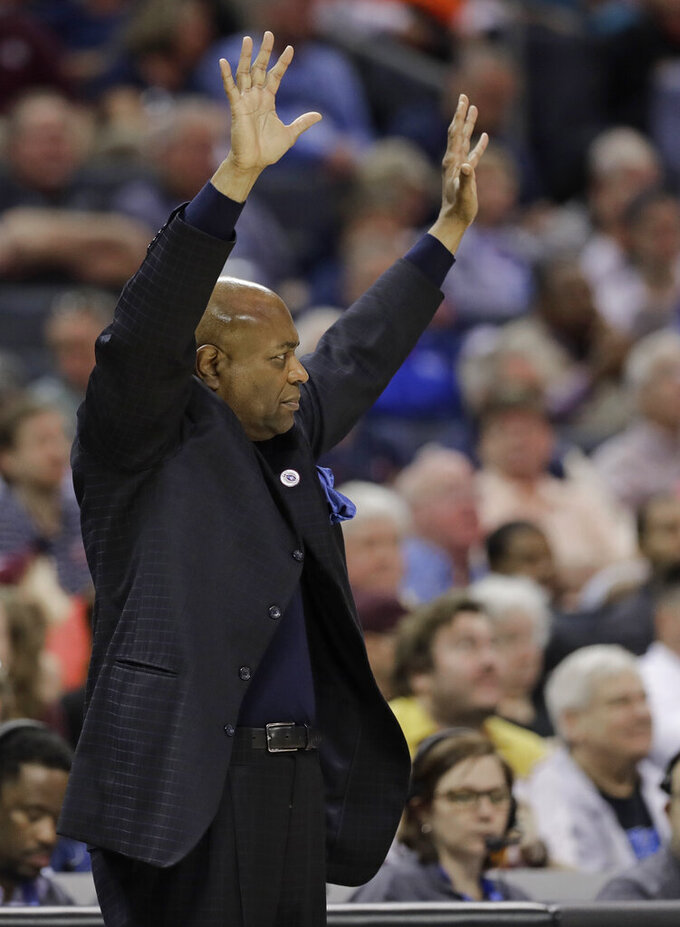Florida State head coach Leonard Hamilton directs his team against Virginia Tech during the second half of an NCAA college basketball game in the Atlantic Coast Conference tournament in Charlotte, N.C., Thursday, March 14, 2019. (AP Photo/Chuck Burton)