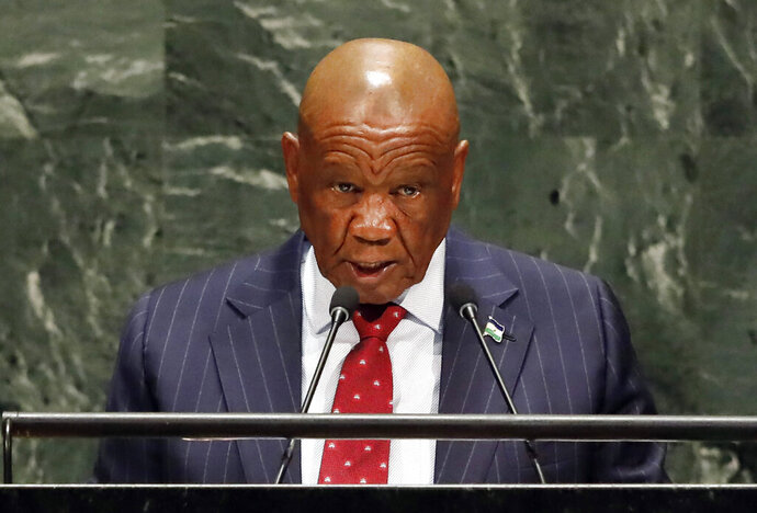 FILE — In this Friday, Sept. 27, 2019, file photo Lesotho's Prime Minister Thomas Motsoahae Thabane addresses the 74th session of the United Nations General Assembly.  Thabane's wife and First Lady, Maesaiah Thabane is in hiding from police, Tuesday Jan. 14, 2020, who want to question her over the June 14, 2017, killing of Thabane's former wife Lipolelo. (AP Photo/Richard Drew, File)