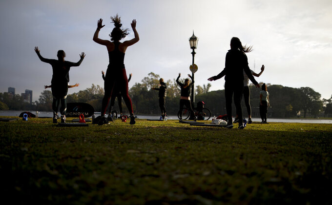 People exercise at a park amid the COVID-19 pandemic in Buenos Aires, Argentina, Wednesday, June 2, 2021. (AP Photo/Natacha Pisarenko)
