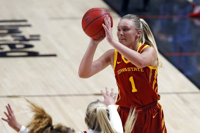 Iowa State's Madison Wise (1) shoots the ball over Texas Tech's Bryn Gerlich (20) during the second half of an NCAA college basketball game Sunday, Jan. 10, 2021, in Lubbock, Texas. (Brad Tollefson/Lubbock Avalanche-Journal via AP)