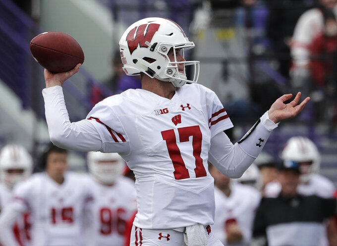 Wisconsin quarterback Jack Coan looks to pass against Northwestern during the first half of an NCAA college football game in Evanston, Ill., Saturday, Oct. 27, 2018. (AP Photo/Nam Y. Huh)
