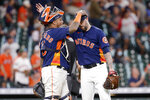 Houston Astros catcher Martin Maldonado, left, and closing pitcher Ryan Pressly, right, pat each other on the head after their 3-1 win over the Los Angeles Angels after a baseball game Sunday, Sept. 12, 2021, in Houston. (AP Photo/Michael Wyke)
