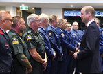 Britain's Prince William, right, meets with Police St. Johns ambulance staff during a visit to the Justice and Emergency Services Precinct in Christchurch, New Zealand, Thursday, April 25, 2019. Prince William is on a two-day visit to New Zealand to take part in ANZAC ceremonies and visit the two mosques where a gunman killed 50 people on March 15. (Marty Melville/Pool Photo via AP)