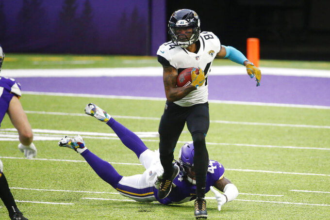 Jacksonville Jaguars wide receiver Keelan Cole Sr. runs from Minnesota Vikings safety Josh Metellus, rear, during the first half of an NFL football game, Sunday, Dec. 6, 2020, in Minneapolis. (AP Photo/Bruce Kluckhohn)