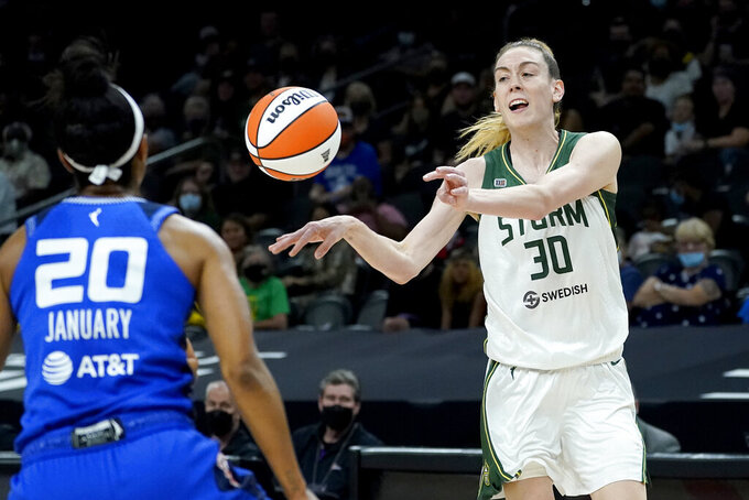 Seattle Storm forward Breanna Stewart (30) passes the ball as Connecticut Sun guard Briann January (20) defends during the first half of the Commissioner's Cup WNBA basketball game, Thursday, Aug. 12, 2021, in Phoenix. (AP Photo/Matt York)