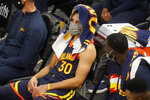 Golden State Warriors guard Stephen Curry (30) sits on the bench in the second half during an NBA basketball game against the Utah Jazz, Saturday, Jan. 23, 2021, in Salt Lake City. (AP Photo/Rick Bowmer)