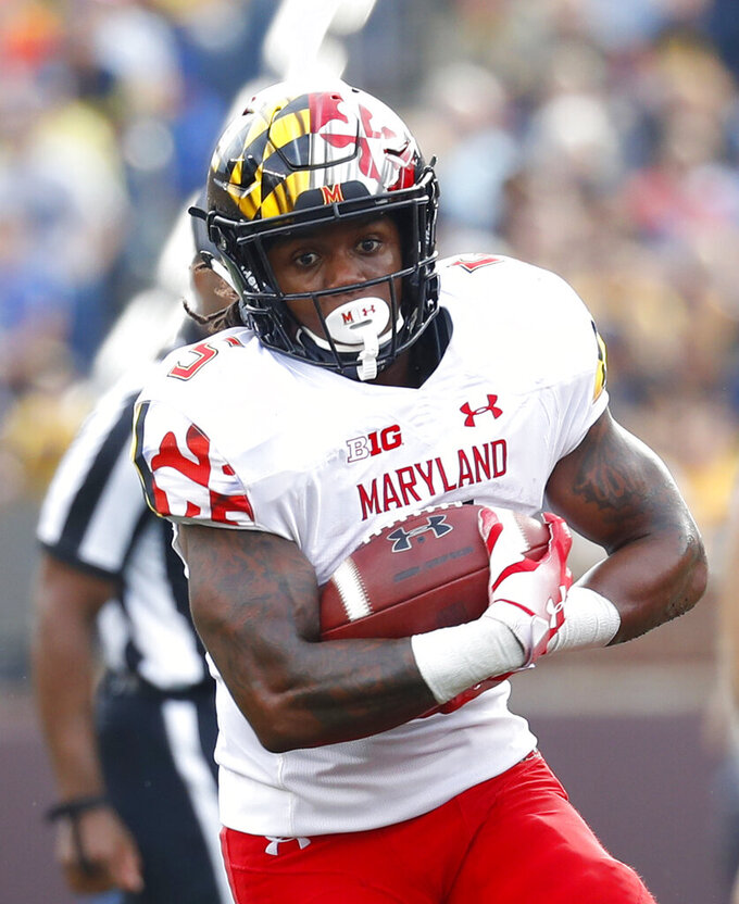 FILE - In this Oct. 6, 2018, file photo, Maryland running back Anthony McFarland runs against Michigan in the second half of an NCAA college football game in Ann Arbor, Mich. Following a miserable 2018 season, the Terrapins start anew Saturday with a home game against neighboring Howard. (AP Photo/Paul Sancya, File)