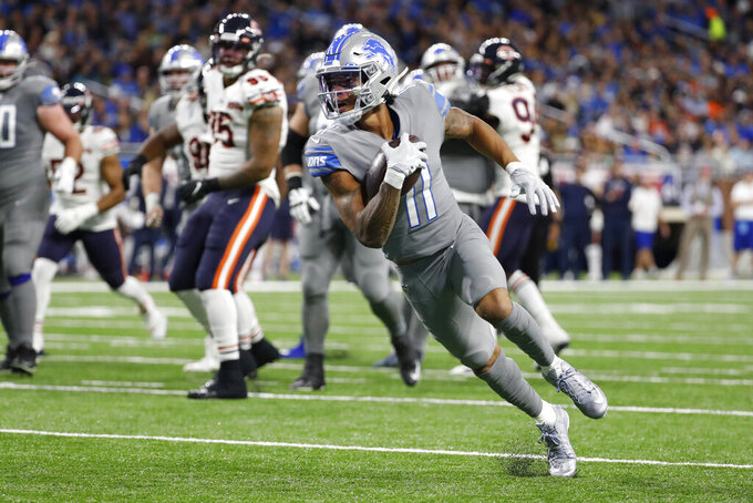 Detroit Lions wide receiver Marvin Jones scores on a 8-yard pass reception for a touchdown during the first half of an NFL football game against the Chicago Bears, Thursday, Nov. 28, 2019, in Detroit. (AP Photo/Rick Osentoski)