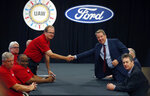 United Auto Workers President Gary Jones, left, and Ford Motor Co., Executive Chairman Bill Ford shake hands to open their contract talks Monday, July 15, 2019, in Dearborn, Mich. (AP Photo/Carlos Osorio)