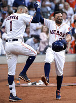 Houston Astros' Jose Altuve, right, celebrates his solo home run off New York Yankees starting pitcher Masahiro Tanaka with Carlos Correa during the fourth inning of a baseball game, Monday, April 8, 2019, in Houston. (AP Photo/Eric Christian Smith)