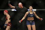 Maycee Barber, right, reacts after defeating Gillian Robertson during a women's flyweight mixed martial arts bout Friday, Oct. 18, 2019, at UFC Fight Night in Boston. (AP Photo/Elise Amendola)