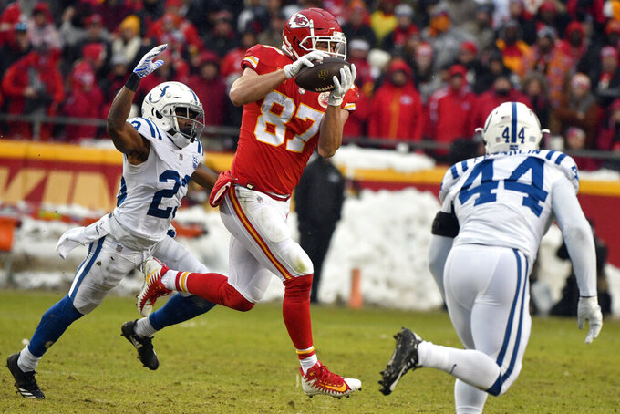 FILE - In this Jan. 12, 2019, file photo, Kansas City Chiefs tight end Travis Kelce (87) makes a catch in front of Indianapolis Colts cornerback Kenny Moore (23) during the first half of an NFL divisional football playoff game in Kansas City, Mo. Two-time All-Pro tight end Travis Kelce was spectacular in catches (103), yards receiving (1,336) and touchdowns (10) last season. (AP Photo/Ed Zurga, File)