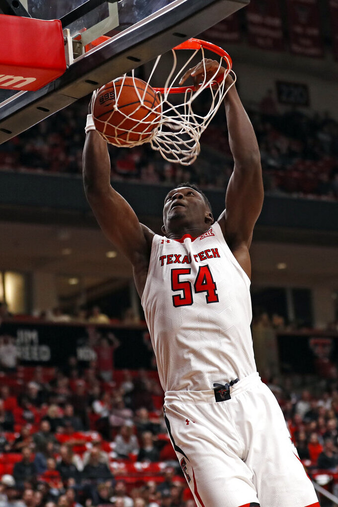 Texas Tech's Russel Tchewa (54) dunks the ball during the second half of an NCAA college basketball game against Eastern Illinois, Tuesday, Nov. 5, 2019, in Lubbock, Texas. (AP Photo/Brad Tollefson)