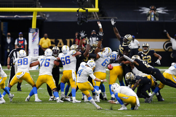 Los Angeles Chargers kicker Mike Badgley (4) attempts a field goal that was no good, forcing overtime, in the second half of an NFL football game in New Orleans, Monday, Oct. 12, 2020. (AP Photo/Butch Dill)