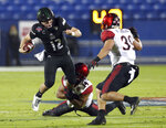 Ohio quarterback Nathan Rourke (12) gets tackled by San Diego State safety Tariq Thompson (14) in the first half of the Frisco Bowl NCAA college football game, Wednesday, Dec. 19, 2018, in Frisco, Texas. (AP Photo/Richard W. Rodriguez)