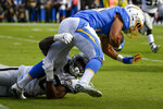 Los Angeles Chargers running back Austin Ekeler is tackled by Oakland Raiders linebacker Nicholas Morrow during the first half of an NFL football game Sunday, Dec. 22, 2019, in Carson, Calif. (AP Photo/Kelvin Kuo)