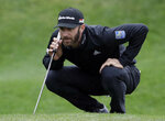 Dustin Johnson lines up a putt on the second hole during the final round of The Players Championship golf tournament Sunday, March 17, 2019, in Ponte Vedra Beach, Fla. (AP Photo/Lynne Sladky)