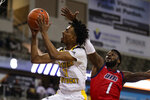 Northern Kentucky guard Jalen Tate (11) shoots in front of Northern Kentucky guard Adham Eleeda (1) during the first half of an NCAA college basketball game for the Horizon League men's tournament championship in Indianapolis, Tuesday, March 10, 2020. (AP Photo/Michael Conroy)