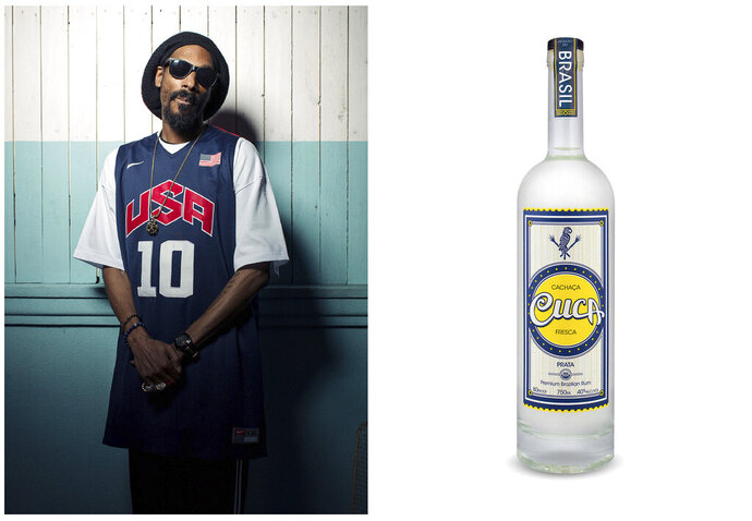This combination photo shows Snoop Dogg posing for a portrait at Miss Lily's in New York on July 30, 2012, left, and a bottle of his Cuca Fresca Cachaça Prata. Celebrities are deep into the liquor and wine business with their own brands that are particularly gifty for drink-loving fans. (AP Photo, left, and Cuca Fresca)