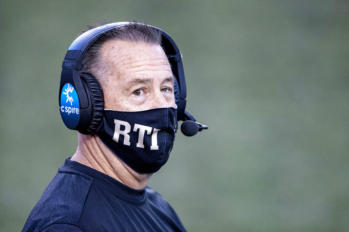 Vanderbilt interim head coach Todd Fitch walks the sideline during the second half of an NCAA college football game against Tennessee, Saturday, Dec. 12, 2020, in Nashville, Tenn. (AP Photo/Wade Payne)