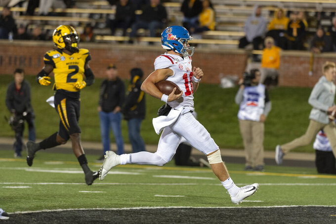 Mississippi quarterback John Rhys Plumlee scores a touchdown in front of Missouri defensive back DeMarkus Acy, left, during the fourth quarter of an NCAA college football game Saturday, Oct. 12, 2019, in Columbia, Mo. (AP Photo/L.G. Patterson)