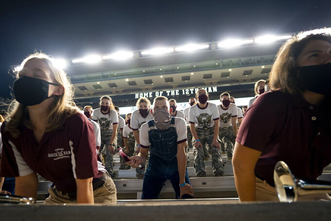 Members of the Texas A&M Corps of Cadets Band practice yells inside of Kyle Field, College Station, Texas  as part of the first Midnight Yell Practice this season early Saturday, Sept. 26, 2020. . Due to Coronavirus restrictions, the band was the only crowd allowed in the normally packed stands for the traditional game day event in College Station, Texas. (Sam Craft/Pool Photo via AP)