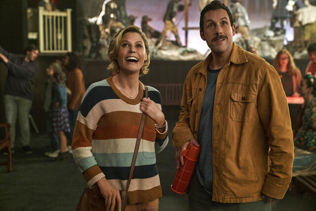 This image released by Netflix shows Julie Bowen, left, and Adam Sandler in a scene from