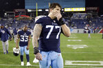 FILE - In this Dec. 30, 2018, file photo, Tennessee Titans offensive tackle Taylor Lewan (77) leaves the field after a 33-17 loss to the  Indianapolis Colts in an NFL football game, in Nashville, Tenn. Lewan, Tennessee's three-time Pro Bowl left tackle, says the NFL has suspended him for the first four games of the season for violating the league's policy on performance-enhancing drugs. Lewan announced his suspension Wednesday, July 24, 2019, in a video he posted to Twitter. (AP Photo/James Kenney, File)