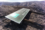 A freeway sign along the Antelope Valley freeway is seen where the Soledad fire has now scorched 1,300 acres, Monday, July 6, 2020. The Soledad fire which broke out Sunday afternoon is now 30% contained as firefighters and hand crews work through high temperatures to make sure the flames are contained. (David Crane/The Orange County Register/SCNG via AP)
